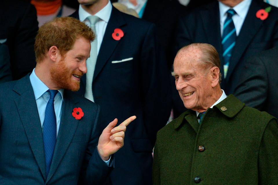 Prince Harry speaks with his grandfather Prince Philip as they watch the final match of the 2015 Rugby World Cup on Oct. 31, 2015. (Photo: GLYN KIRK via Getty Images)