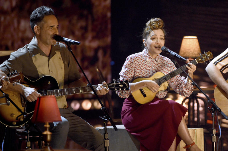 """Jorge Drexler, left, and Natalia LaFourcade perform """"Telefonia"""" at the Latin Grammy Awards on Thursday, Nov. 15, 2018, at the MGM Grand Garden Arena in Las Vegas. (Photo by Chris Pizzello/Invision/AP)"""