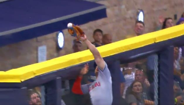 Giancarlo Stanton just misses taking a home run away from Domingo Santana. (Fox Sports)