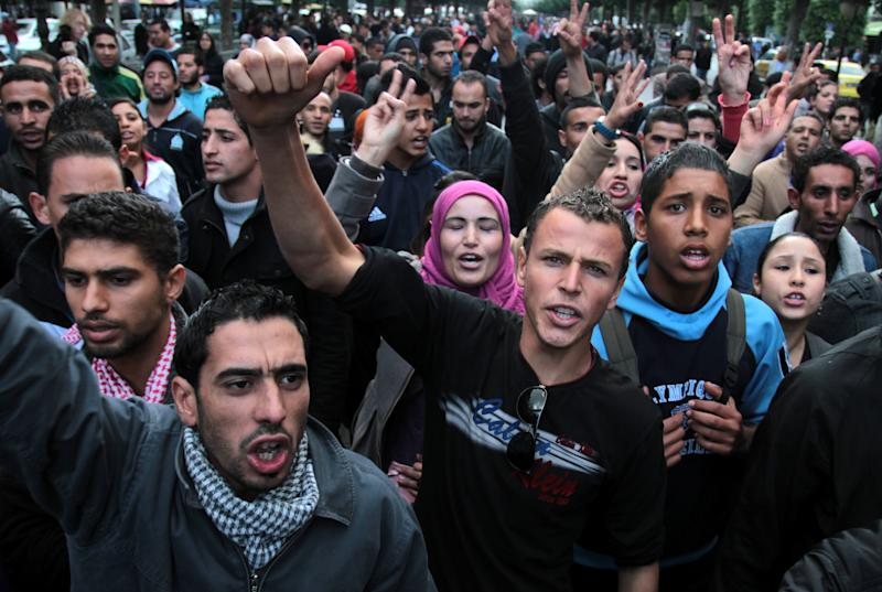 People demonstrate in Tunis , to protest police violence in Tunisian town of Siliana Thursday, Nov. 29, 2012. Tunisia's army intervened Thursday in a third day of violent clashes in a northern town between police and striking residents who are demanding jobs and investment. After two days of battles that a hospital said left more than 300 people injured, police pulled out of Siliana Wednesday night. Witnesses said 15,000 people marched through the town Thursday demanding the governor's resignation. (AP Photo/Amine Landoulsi)