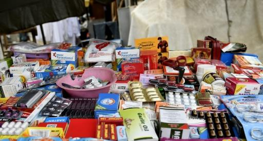 A drugs stall on a street in Lagos. Informal sales outlets are a major channel for counterfeit medicine