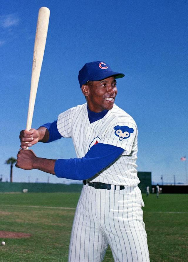 FILE - In this 1968 file photo, Chicago Cubs' Ernie Banks poses with a baseball bat. The Cubs announced Friday night, Jan. 23, 2015, that Banks had died. He was 83. (AP Photo/File)