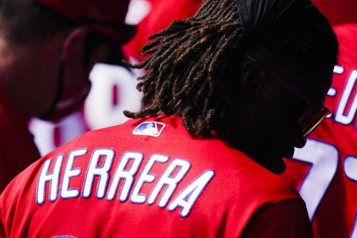 Philadelphia Phillies' Odubel Herrera walks in the dugout during the fourth inning of a spring baseball game against the Toronto Blue Jays, Tuesday, March 2, 2021, in Dunedin, Fla. The Blue Jays won 4-2. (AP Photo/Frank Franklin II)