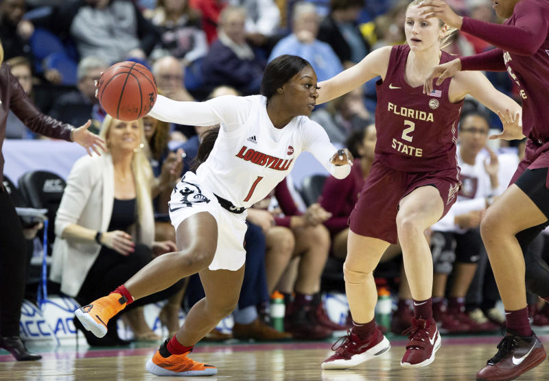 Louisville's Dana Evans (1) handles the ball as Florida State's Sammie Puisis (2) defends during an NCAA college basketball game at the Atlantic Coast Conference women's tournament in Greensboro, N.C., Saturday, March 7, 2020. (AP Photo/Ben McKeown)