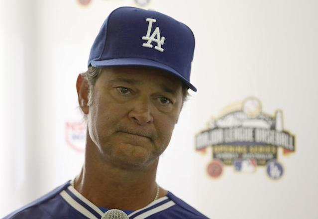 The Los Angeles Dodgers' manager Don Mattingly listens to a question during a press conference at the Sydney Cricket Ground in Sydney Tuesday, March 18, 2014. The MLB season-opening two-game series between the Los Angeles Dodgers and Arizona Diamondbacks in Sydney will be played this weekend. (AP Photo/Rick Rycroft)