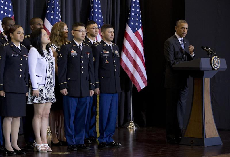 President Barack Obama, right, speaks at a naturalization ceremony at the National War Memorial, Friday, April 25, 2014, in Seoul, South Korea. (AP Photo/Carolyn Kaster)