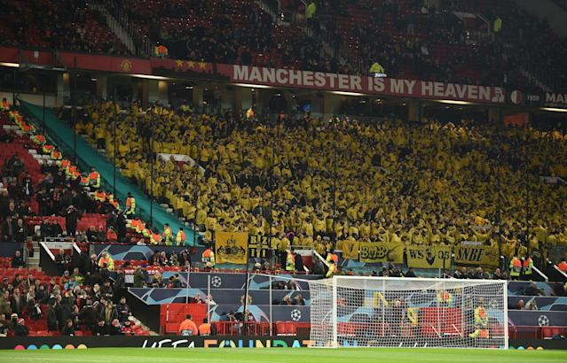 Manchester United are considering using netting for every game in front of the away fans to protect disabled fans