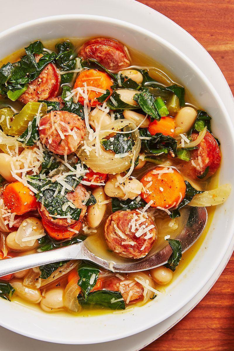 """<p>A good, hearty <a href=""""https://www.delish.com/uk/cooking/recipes/g28794441/vegetable-soup/"""" rel=""""nofollow noopener"""" target=""""_blank"""" data-ylk=""""slk:soup"""" class=""""link rapid-noclick-resp"""">soup</a> is one of our favourite ways to warm up in the colder months. And this Slow Cooker Sausage and White Bean Soup will do that perfectly. </p><p>Get the <a href=""""https://www.delish.com/uk/cooking/recipes/a29794477/slow-cooker-sausage-and-white-bean-soup-recipe/"""" rel=""""nofollow noopener"""" target=""""_blank"""" data-ylk=""""slk:Slow Cooker Sausage & White Bean Soup"""" class=""""link rapid-noclick-resp"""">Slow Cooker Sausage & White Bean Soup</a> recipe. </p>"""