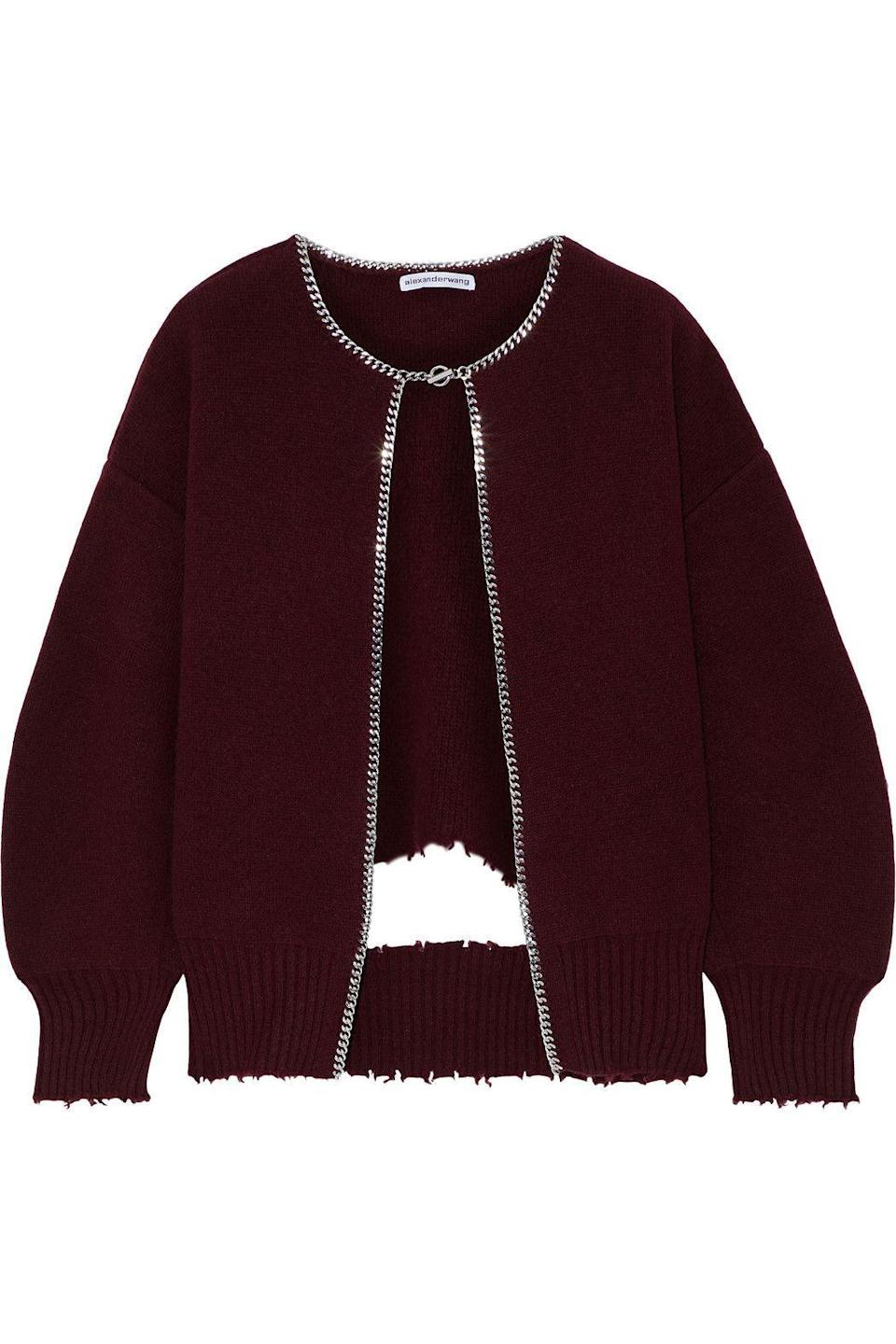 """<p><strong>ALEXANDER WANG</strong></p><p>theoutnet.com</p><p><strong>$299.00</strong></p><p><a href=""""https://go.redirectingat.com?id=74968X1596630&url=https%3A%2F%2Fwww.theoutnet.com%2Fen-us%2Fshop%2Fproduct%2Falexander-wang%2Fjackets%2Fsmart-jackets%2Fdistressed-chain-trimmed-wool-blend-cardigan%2F2204324140848602&sref=https%3A%2F%2Fwww.harpersbazaar.com%2Ffashion%2Ftrends%2Fg34788766%2Fthe-outnets-black-friday-sale-2020%2F"""" rel=""""nofollow noopener"""" target=""""_blank"""" data-ylk=""""slk:Shop Now"""" class=""""link rapid-noclick-resp"""">Shop Now</a></p><p>This is not your grandmonther's cardigan. </p>"""
