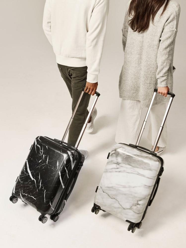 """<h2>CALPAK Astyll Carry-On Luggage</h2><br><br><strong>The Type:</strong> Standard carry-on roller bag<br><br><strong>The Hype:</strong> 5 out of 5 stars and 26 reviews on CALPAK<br><br><strong>What Travelers Say: </strong>""""This suitcase is GORGEOUS, and it's just as functional as it is fashionable! Incredibly streamlined and well-designed, yet holds a ton!"""" – J<em>essica F., CALPAK Reviewer</em><br><br><em>Shop</em> <strong><em><a href=""""http://calpak.com"""" rel=""""nofollow noopener"""" target=""""_blank"""" data-ylk=""""slk:CALPAK"""" class=""""link rapid-noclick-resp"""">CALPAK</a></em></strong><em><br></em><br><br><strong>CALPAK Travel</strong> Astyll Carry-On Luggage, $, available at <a href=""""https://go.skimresources.com/?id=30283X879131&url=https%3A%2F%2Fwww.calpaktravel.com%2Fproducts%2Fastyll-carry-on-luggage%2Fmilk-marble"""" rel=""""nofollow noopener"""" target=""""_blank"""" data-ylk=""""slk:CALPAK Travel"""" class=""""link rapid-noclick-resp"""">CALPAK Travel</a>"""