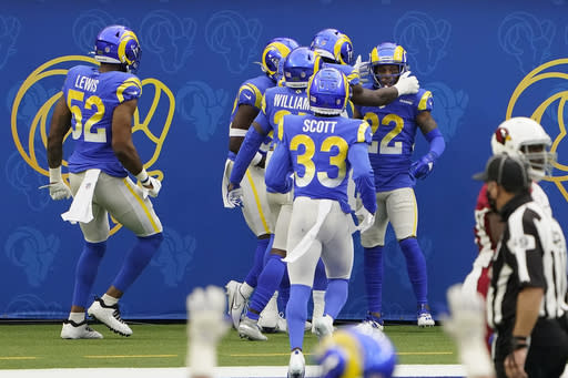 Los Angeles Rams cornerback Troy Hill (22) is congratulated by teammates after returning an interception for a touchdown against the Arizona Cardinals during the first half of an NFL football game in Inglewood, Calif., Sunday, Jan. 3, 2021. (AP Photo/Jae C. Hong)