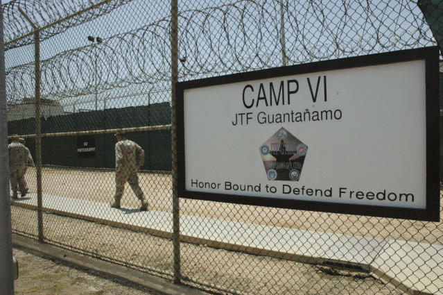 GUANTANAMO BAY NAVAL BASE, CUBA - JULY 23: In this image reviewed by the U.S. Military, a sign marks one of the entrances to the Camp VI detention center July 23, 2008 at Guantanamo Bay U.S. Naval Base, in Cuba. The military base is providing the location for the trial of Salim Hamdan, the former driver for Osama bin Laden, who is charged with conspiracy and aiding terrorism and is the first prisoner to face a U.S. war-crimes trial since World War II. (Randall Mikkelsen-Pool/Getty Images)