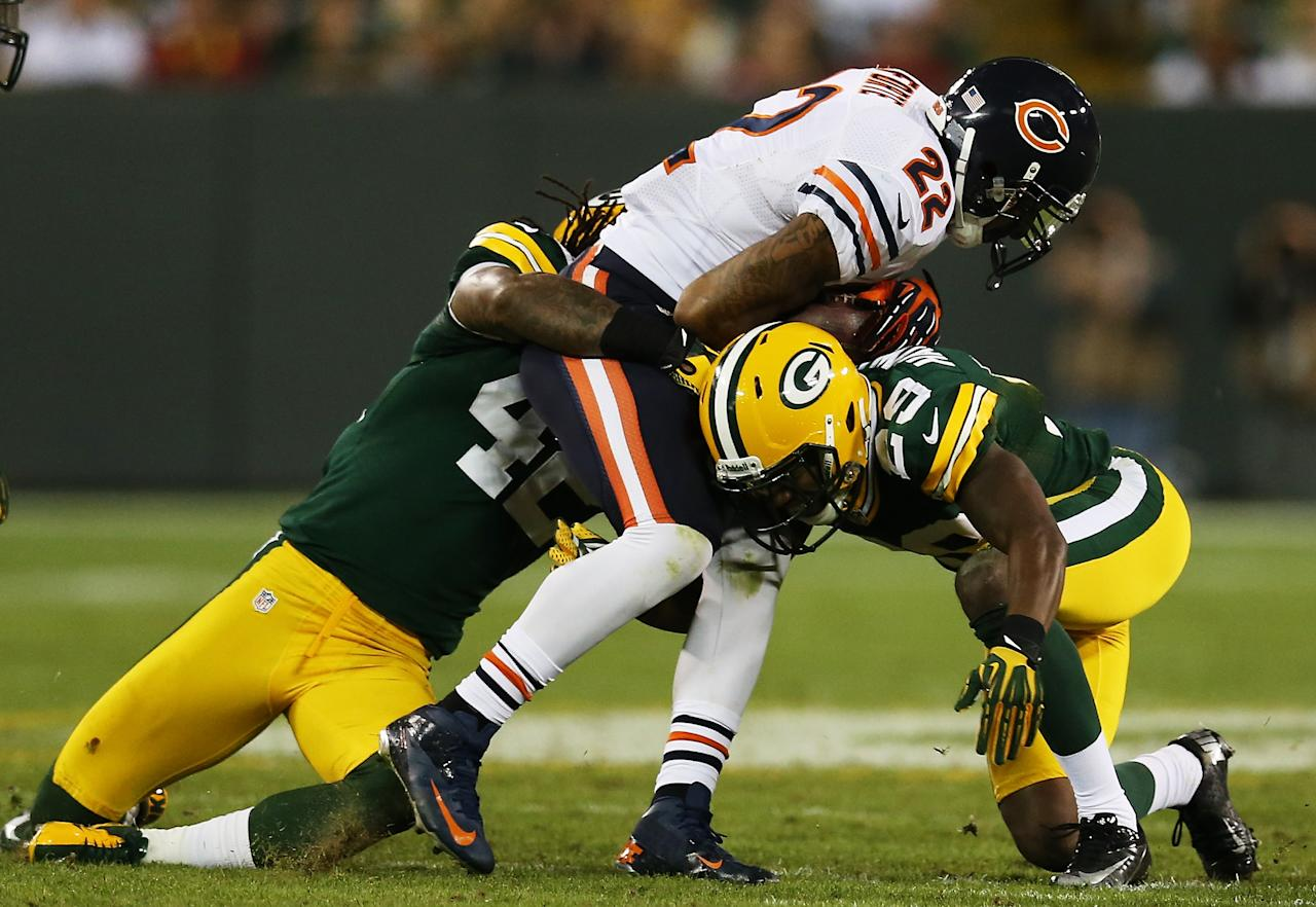 GREEN BAY, WI - SEPTEMBER 13:  Running back Matt Forte #22 of the Chicago Bears runs against free safety Morgan Burnett #42 and cornerback Casey Hayward #29 of the Green Bay Packers in the second quarter at Lambeau Field on September 13, 2012 in Green Bay, Wisconsin.  (Photo by Jonathan Daniel/Getty Images)