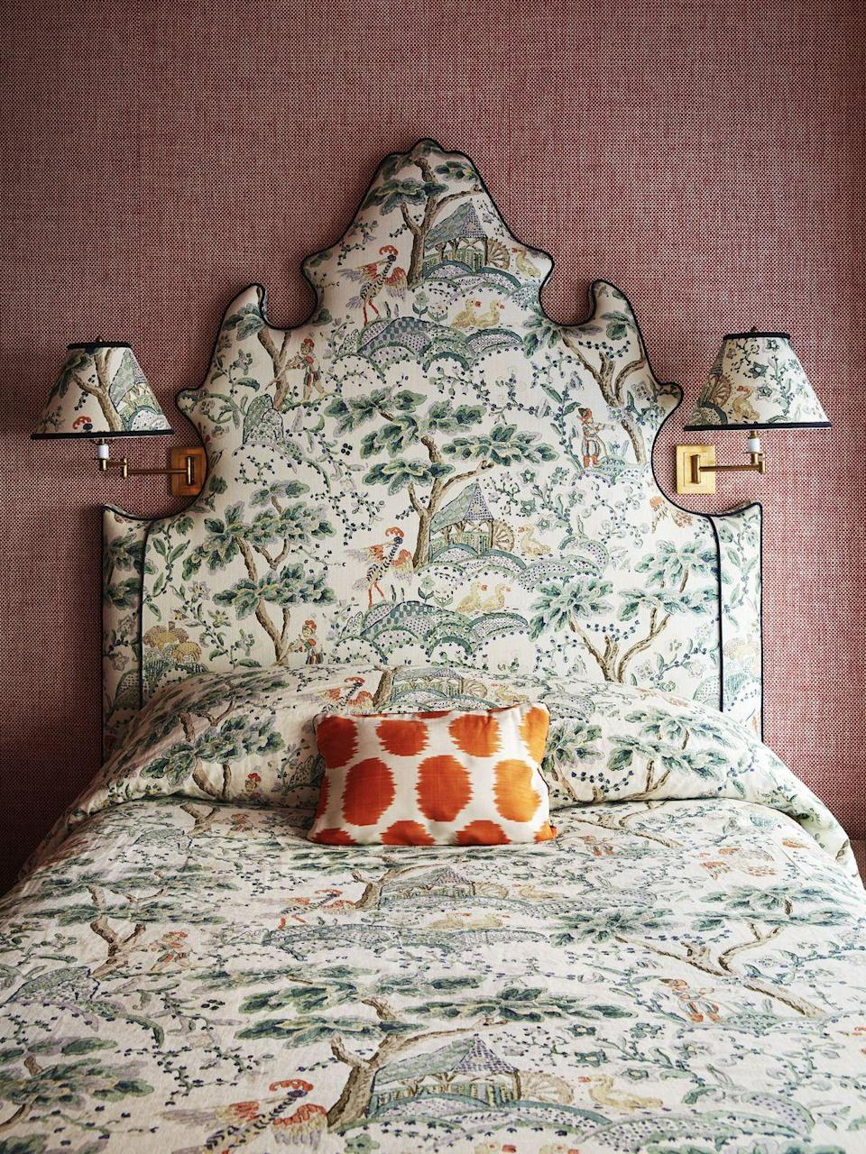 "<p>Heavy patterned fabric fans, this one's for you. This delightful guest bedroom in <a href=""https://www.veranda.com/decorating-ideas/house-tours/a34244505/chiqui-woolworth-nyc-apartment-tour/"" rel=""nofollow noopener"" target=""_blank"" data-ylk=""slk:a Manhattan apartment designed by Chiqui Woolworth"" class=""link rapid-noclick-resp"">a Manhattan apartment designed by Chiqui Woolworth</a> utilizes an archival English fabric from <a href=""https://www.scalamandre.com/"" rel=""nofollow noopener"" target=""_blank"" data-ylk=""slk:Scalamandré"" class=""link rapid-noclick-resp"">Scalamandré</a> to adorn the bed's uniquely shaped headboard, bed, and the adjacent sconces for a bold look that doesn't feel loud. </p>"