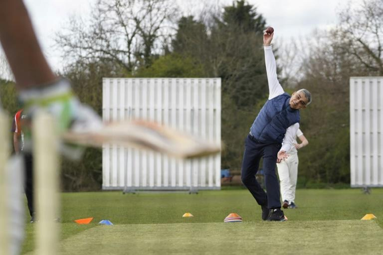Bowling them over - London Mayor Sadiq Khan in action at Kingstonian Cricket Club, southwest London, on Friday
