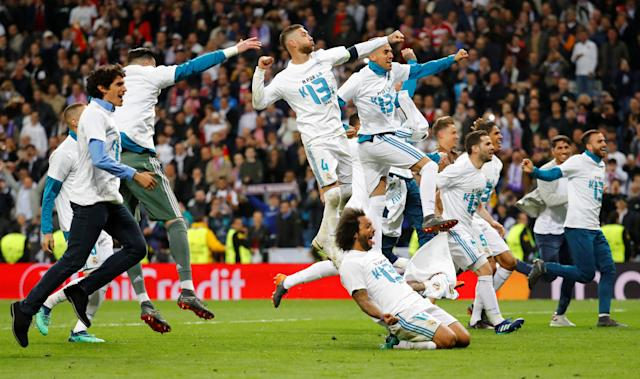 Soccer Football - Champions League Semi Final Second Leg - Real Madrid v Bayern Munich - Santiago Bernabeu, Madrid, Spain - May 1, 2018 Real Madrid's Sergio Ramos, Marcelo and teammates celebrate after the match REUTERS/Kai Pfaffenbach TPX IMAGES OF THE DAY