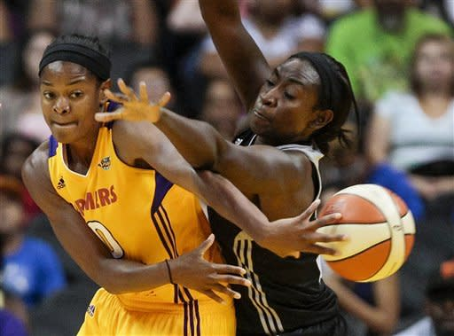 Los Angeles Sparks forward Alana Beard (0) passes the ball around San Antonio Silver Stars forward Sophia Young during the first half of a WNBA basketball game, Thursday, Aug. 23, 2012, in Los Angeles. (AP Photo/Bret Hartman)