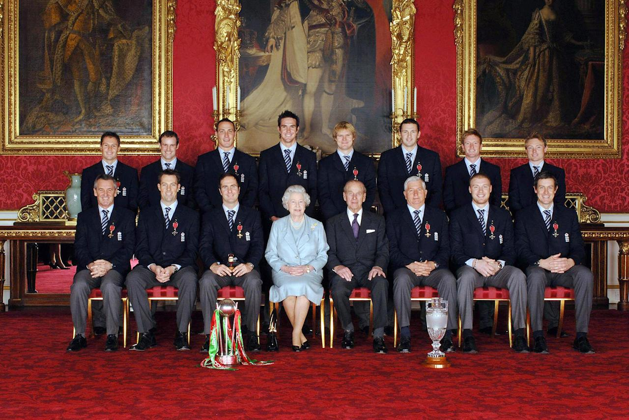 London, United Kingdom:  Members of England's 2005 Ashes winning Cricket team sit with Britain's Queen Elizabeth II (4th from L) and the Duke of Edinburgh (4th from R) in Buckingham Palace in London, 09 February  2006, after collecting their honours at an investiture ceremony. Back row from left: Geraint Jones (Kent), Andrew Strauss (Middlesex), Simon Jones (Glamorgan), Kevin Pietersen (Hampshire), Stephen Harmison (Durham), Matthew Hoggard (Yorkshire), Paul Collingwood (Durham), Ian Bell (Durham). Front row from left: Phil Neale (Manager), Marcus Threscothick (Somerset), Michael Vaughan (Yorkshire), Queen Elizabeth II, the Duke of Edinburgh, Duncan Fletcher (Coach), Andrew Flintoff (Lancashire) and Ashley Giles (Warwickshire). AFP PHOTO/FIONA HANSEN/WPA POOL/PA  (Photo credit should read FIONA HANSEN/AFP/Getty Images)