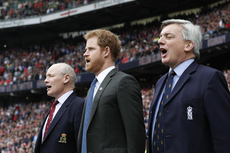 Prince Harry (centre) sings the national anthem at Twickenham stadium ahead of the Army V Royal Navy annual rugby match: PA