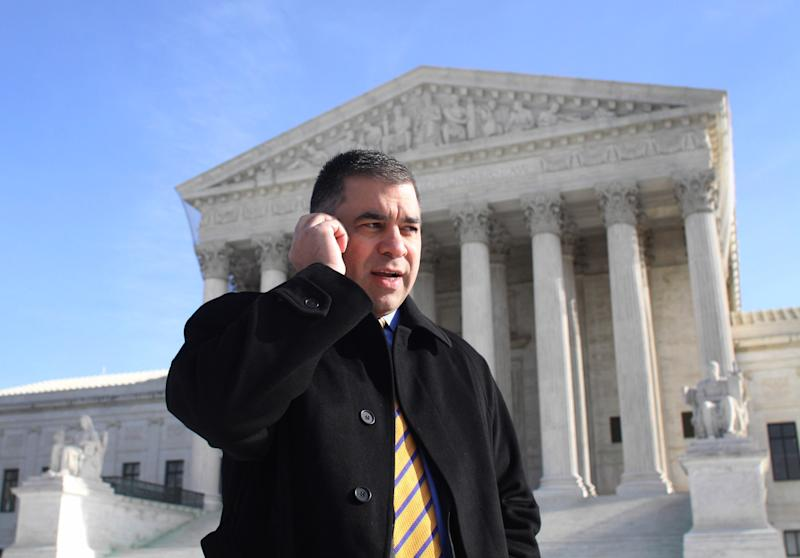 FILE – In this Jan. 21, 2010, file photo Citizens United President David Bossie talks on his cell phone outside the Supreme Court in Washington after the court's ruling on the campaign finance reform case. The emergence of super PACs and other outside groups, emboldened partly by the court's 2010 Citizens United decision, has done more than anything else to reshape the contours of campaign fundraising. Operating with few rules and limited oversight, outside groups spent a record-shattering $1 billion to influence political campaigns last fall.  And the system faces further de-regulation as the Supreme Court prepares to hear a case this year that could wipe away aggregate annual limits on direct contributions to candidates and official campaign committees. (AP Photo/Lauren Victoria Burke, File)