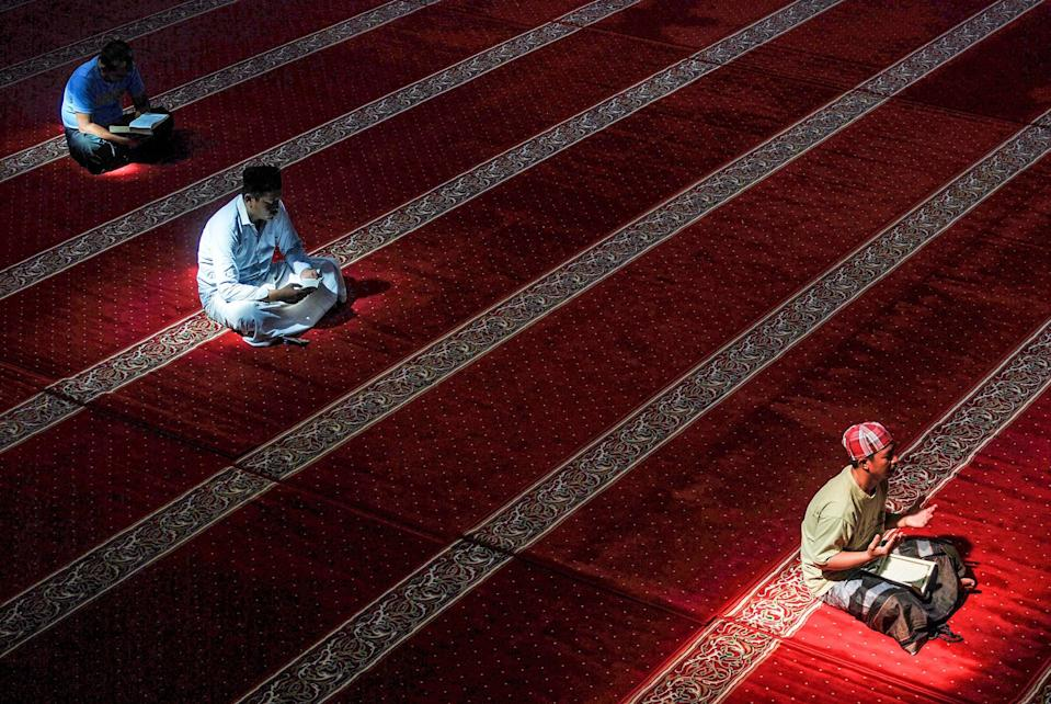 Indonesian Muslims read the Koran at a Mosque in Bandung, West Java during the month of Ramadan. (AFP/Getty)