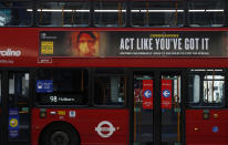 A lone bus passenger sits on the top deck, wearing a mask to prevent the spread of COVID-19, in Oxford Street London, Tuesday, Jan. 26, 2021. The U.K. will soon become the fifth country in the world to record 100,000 COVID-19 deaths, after the United States, Brazil, India and Mexico — all of which have much larger populations than Britain's 67 million people. As of Monday, the U.K.'s official coronavirus death toll was 98,531. (AP Photo/Alastair Grant)