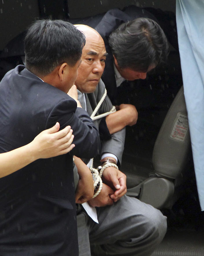 Pro-North Korean activist No Su-hui arrives at a police station after he crossed the Demilitarized Zone into South Korea in Paju, South Korea, Thursday, July 5, 2012. South Korean police arrested the activist for making an extended trip to Pyongyang without government approval. (AP Photo/Yonhap, Im Byung-sik) KOREA OUT