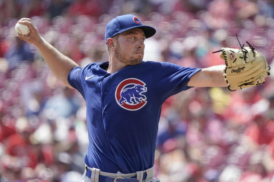 Chicago Cubs starting pitcher Adrian Sampson throws during the first inning of a baseball game against the Cincinnati Reds in Cincinnati, Wednesday, Aug. 18, 2021. (AP Photo/Jeff Dean)