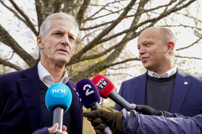 Norway's prime minister-designate and leader of the Labor Party Jonas Gahr Stoere, left, and Trygve Slagsvold Vedum, leader of the Center Party, attend a press conference in Hurdal, Norway, Wednesday Oct. 13, 2021. Jonas Gahr Stoere presented his proposal for a two-party, center-left, minority government and its polices after the left-leaning bloc including his Labor Party won last month's parliament elections. (Torstein Boe/NTB via AP)
