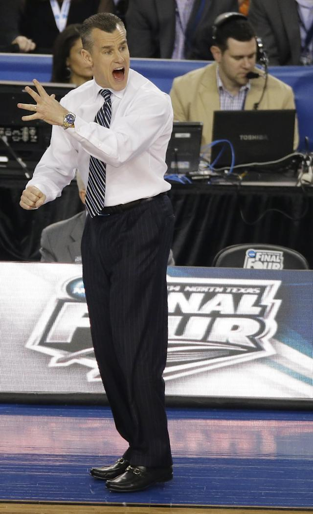 Florida head coach Billy Donovan reacts during the first half of an NCAA Final Four tournament college basketball semifinal game against Connecticut Saturday, April 5, 2014, in Arlington, Texas. (AP Photo/Tony Gutierrez)
