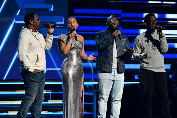 Boyz II Men join Alicia Keys to sing a tribute to Kobe Bryant at the start of the 62nd annual GRAMMY Awards.