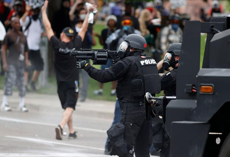 Denver police fire pepper balls during a protest outside the State Capitol on May 30, 2020.