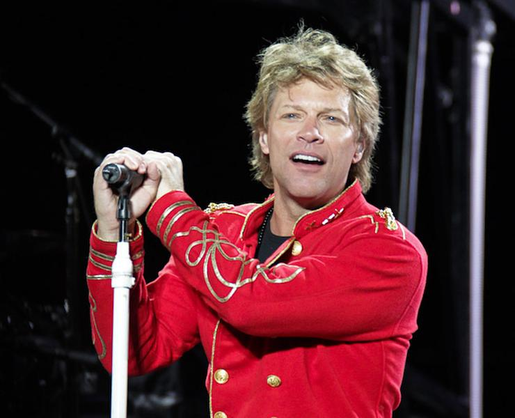 "FILE - This July 27, 2011 file photo shows singer Jon Bon Jovi performing during Bon Jovi's ""Open Air Tour"" show at Estadio Olympico, in Barcelona, Spain. A New Jersey man will face five years in prison after pleading guilty to a string of burglaries at the Jersey shore, including the home of rocker Jon Bon Jovi. Nicholas Tracy of Beachwood pleaded guilty Tuesday to three counts of theft and burglary from a spree that netted him more than $300,000 worth of jewelry and personal items from the homes. The thefts took place in March and April 2011 along the Middletown Township road where Bon Jovi lives. (AP Photo/Job Vermeulen, file)"