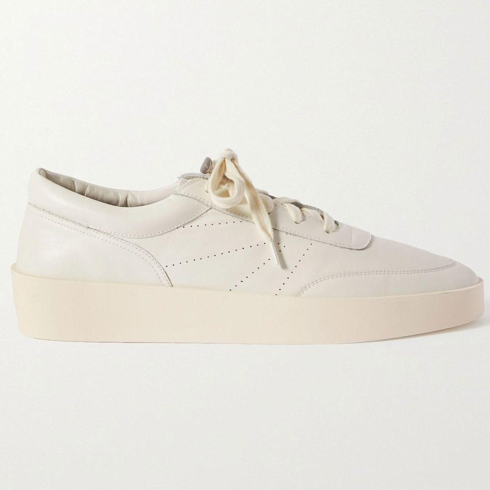 """<p><strong>Fear of God</strong></p><p>mrporter.com</p><p><strong>$595.00</strong></p><p><a href=""""https://go.redirectingat.com?id=74968X1596630&url=https%3A%2F%2Fwww.mrporter.com%2Fen-us%2Fmens%2Fproduct%2Ffear-of-god%2Fshoes%2Flow-top-sneakers%2Fleather-sneakers%2F46353151654231655&sref=https%3A%2F%2Fwww.esquire.com%2Fstyle%2Fmens-fashion%2Fg36504642%2Fbest-new-menswear-may-21-2021%2F"""" rel=""""nofollow noopener"""" target=""""_blank"""" data-ylk=""""slk:Shop Now"""" class=""""link rapid-noclick-resp"""">Shop Now</a></p><p>Speaking of not sleeping on sneakers: You have a chance to get some from Fear of God. Don't miss your window.</p>"""
