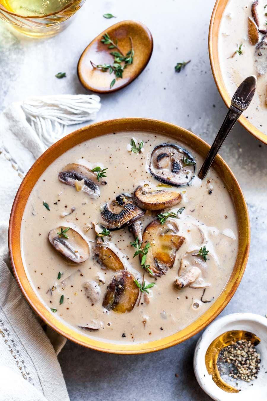 """<p>The classic, reinvented — blitzed cashews stand in for traditional dairy in this bowl-licking good soup. Jamie Vespa, MS, RD, suggests a blend of shiitake and cremini mushrooms for the best bowl possible.</p><p><em><em><a href=""""https://dishingouthealth.com/vegan-cream-of-mushroom-soup/"""" rel=""""nofollow noopener"""" target=""""_blank"""" data-ylk=""""slk:Get the recipe from Dishing Out Health »"""" class=""""link rapid-noclick-resp"""">Get the recipe from Dishing Out Health »</a></em></em><br></p>"""