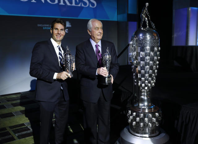 "Will Power, left, winner of the 2018 Indianapolis 500, holds his ""Baby Borg"" driver's trophy as he stands with Roger Penske, who holds his team owner's trophy, in Detroit, Wednesday, Jan. 16, 2019. At right is the Borg-Warner Trophy. (AP Photo/Paul Sancya)"