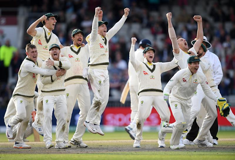 MANCHESTER, ENGLAND - SEPTEMBER 08: Australia celebrate the final wicket of Craig Overton of England to win the Test Match and retain the Ashes during Day Five of the 4th Specsavers Ashes Test between England and Australia at Old Trafford on September 08, 2019 in Manchester, England. (Photo by Alex Davidson/Getty Images)