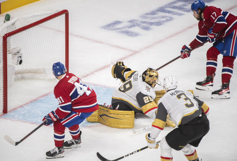 Montreal Canadiens' Josh Anderson (17) scores against Vegas Golden Knights goaltender Marc-Andre Fleury as Canadiens' Paul Byron and Knights' Brayden McNabb (3) look for the rebound during overtime in Game 3 of an NHL hockey semifinal series, Friday, June 18, 2021, in Montreal. (Graham Hughes/The Canadian Press via AP)