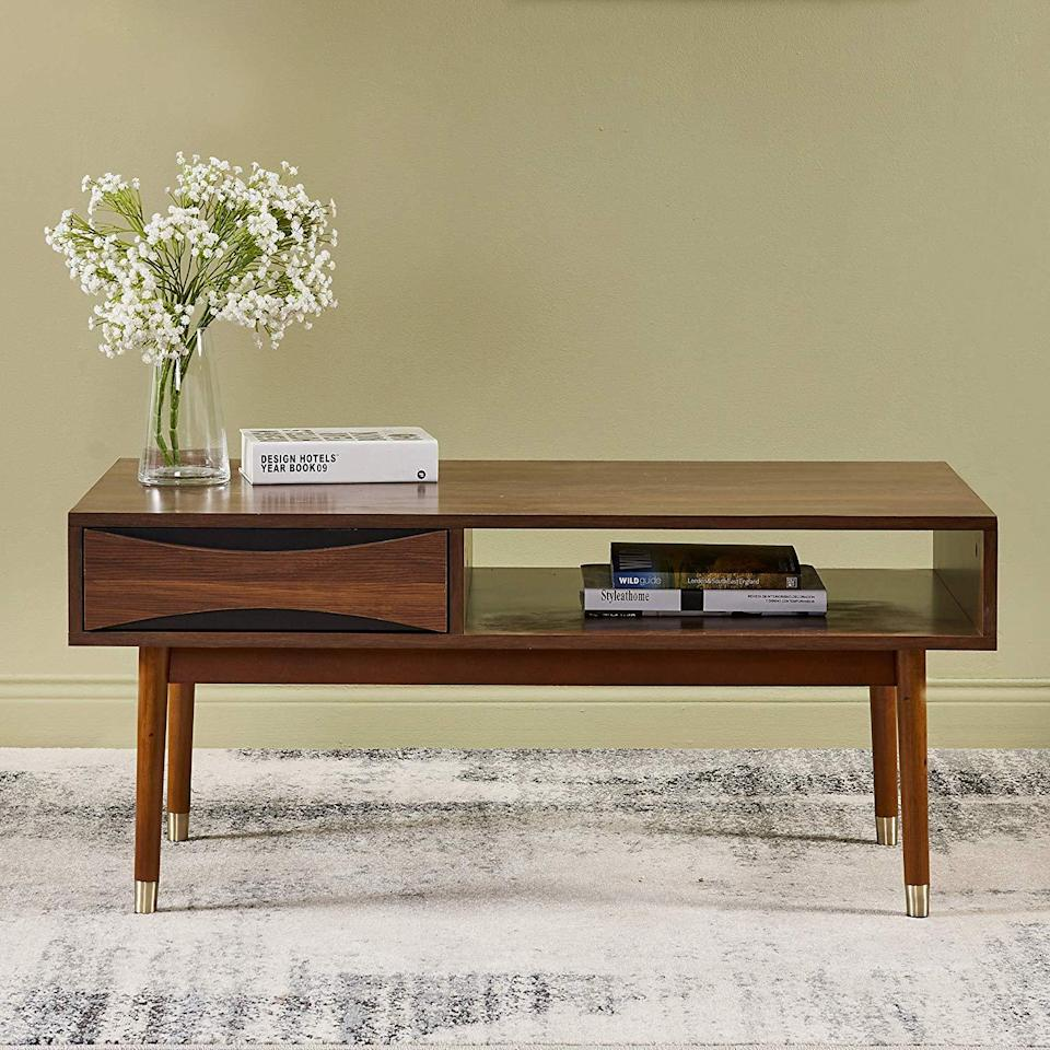 """<h3><a href=""""https://amzn.to/323Ay2m"""" rel=""""nofollow noopener"""" target=""""_blank"""" data-ylk=""""slk:Storage Coffee Table"""" class=""""link rapid-noclick-resp"""">Storage Coffee Table</a></h3><br><strong>Corrie</strong><br><br><strong>How She Discovered It:</strong> """"I was looking for coffee tables.""""<br><br><strong>Why It's A Hidden Gem:</strong> """"It holds a lot of stuff which is really useful in my tiny apartment. I can store things in it for my living room where I am lacking storage. It is also very clean and neat looking. The style goes perfectly with my West Elm couch and looks much higher-end than it is. """"<br><br><strong>Versanora</strong> Dawson Coffee Table, $, available at <a href=""""https://amzn.to/323Ay2m"""" rel=""""nofollow noopener"""" target=""""_blank"""" data-ylk=""""slk:Amazon"""" class=""""link rapid-noclick-resp"""">Amazon</a>"""