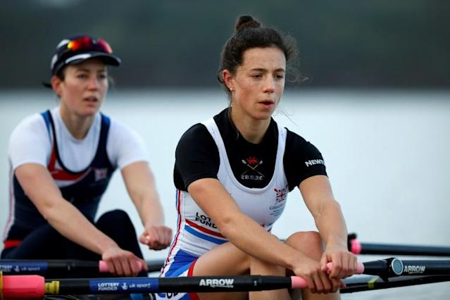 Britain's Imogen Grant (right) and Emily Craig row in a double scull at a training camp in Avis, Portugal (AFP Photo/ADRIAN DENNIS)