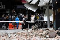 The rare quake shook buildings, knocked down walls and sent panicked Melbourne residents running into the streets (AFP/William WEST)