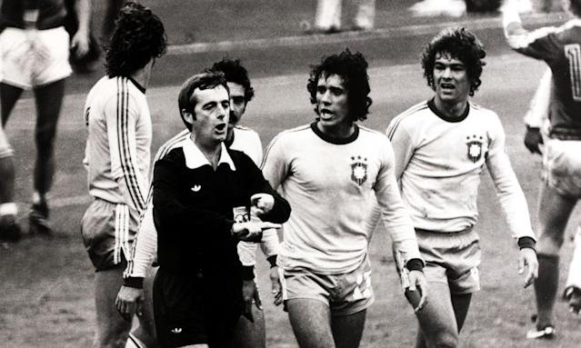 Referee Clive Thomas is surrounded by angry Brazil players after a controversial blowing for full time a moment before Zico scored.