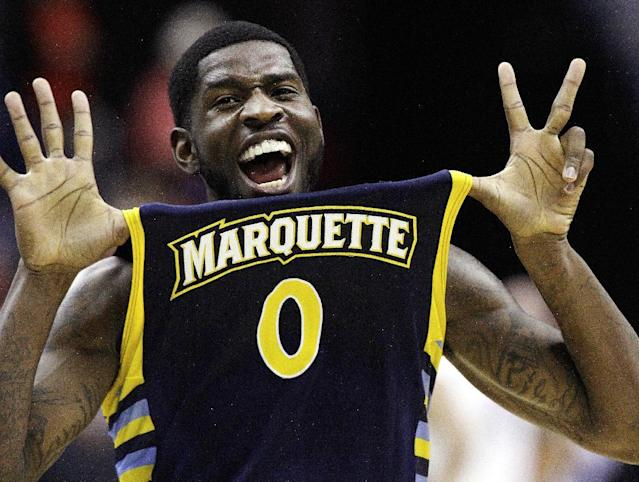 Marquette forward Jamil Wilson (0) celebrates their 71-61 win over Miami in an East Regional semifinal in the NCAA college basketball tournament, Thursday, March 28, 2013, in Washington. Wilson scored 16 points in the victory. (AP Photo/Mark Tenally)