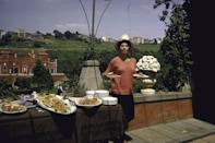<p>Sophia Loren loads up at the buffet at her villa in the Italian countryside in 1964. The film star bought and renovated the 16th century home with her husband, Carlo Ponti, in 1954.</p>