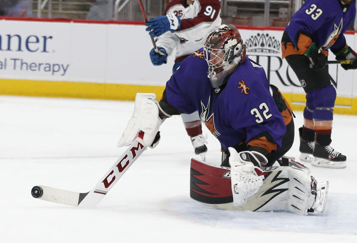 Arizona Coyotes goalie Antti Raanta makes a stick save against the Colorado Avalanche during the third period of an NHL hockey game Saturday, Feb. 27, 2021, in Glendale, Ariz. (AP Photo/Darryl Webb)