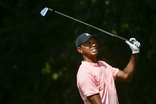 Tiger Woods watches his tee shot on the second hole during the first round of the Tour Championship golf tournament Thursday, Sept. 20, 2018, in Atlanta. (AP Photo/John Amis)