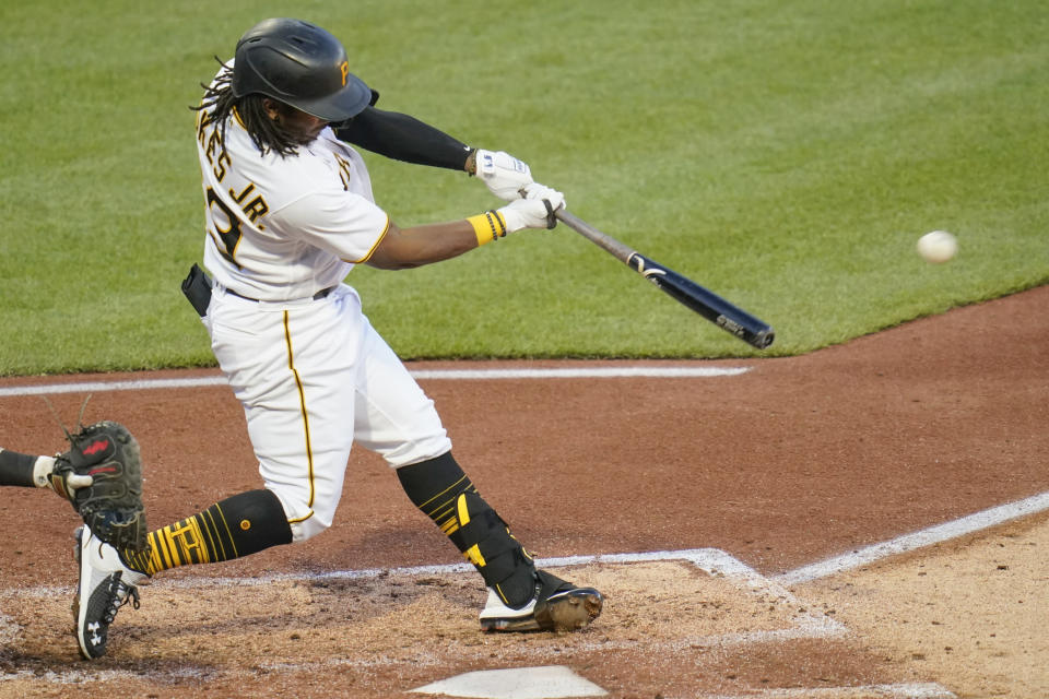 Pittsburgh Pirates' Troy Stokes Jr. drives in a run with a single against the Cincinnati Reds, his first hit in the majors, during the fourth inning of a baseball game Tuesday, May 11, 2021, in Pittsburgh. (AP Photo/Keith Srakocic)