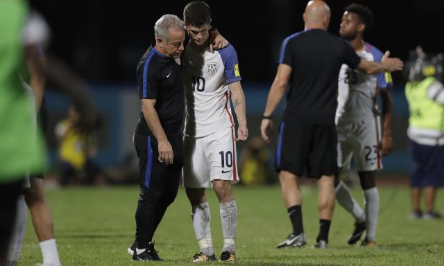 Christian Pulisic, US soccer's brightest hope, is comforted after his team crashed out of World Cup qualifying last year.