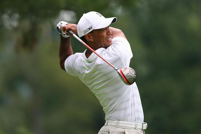 WHITE SULPHUR SPRINGS, WV - JULY 5: Tiger Woods hits his tee shot on the sixth hole during the first round of the Greenbrier Classic at the Old White TPC on July 5, 2012 in White Sulphur Springs, West Virginia. (Photo by Hunter Martin/Getty Images)