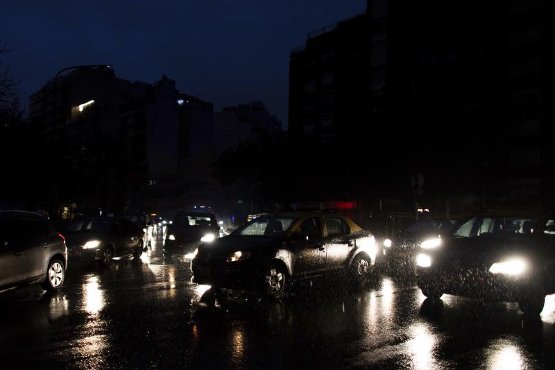 """Cars drive through an unlit street during a blackout in Buenos Aires, Argentina, Sunday, June 16, 2019. A massive blackout left tens of millions of people without electricity in Argentina, Uruguay and Paraguay on Sunday in what the Argentine president called an """"unprecedented"""" failure in the countries' power grid. (AP Photo/Tomas F. Cuesta)"""